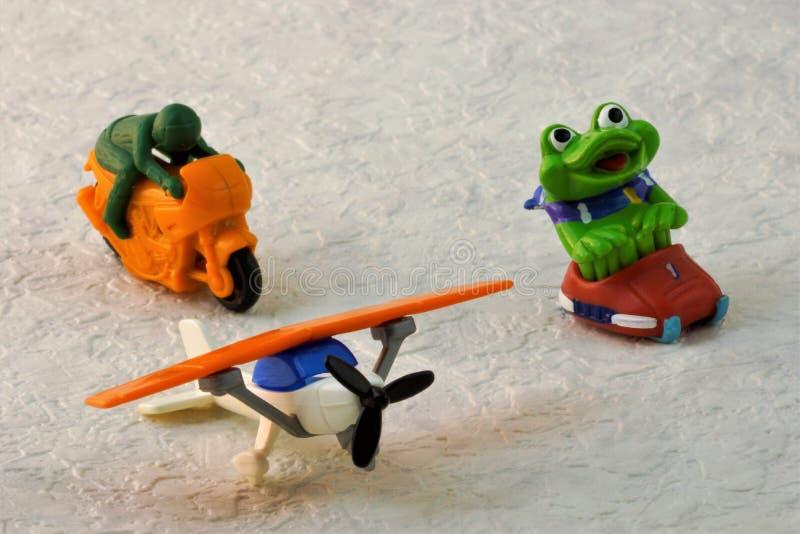 Rennende de sleemotorfiets van het speelgoedvliegtuig stock foto