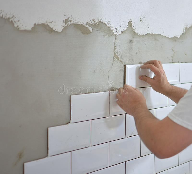 Tiling the tiles in the kitchen stock photo