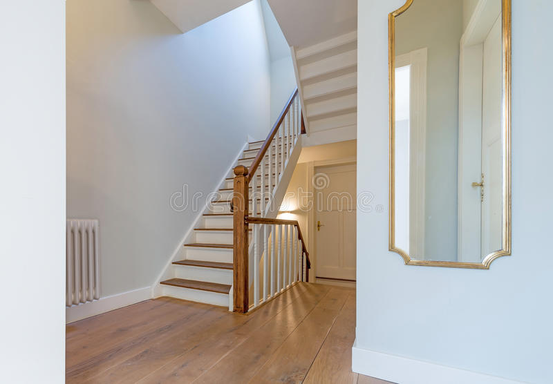 Renovated beautiful staircase with mirror royalty free stock photography