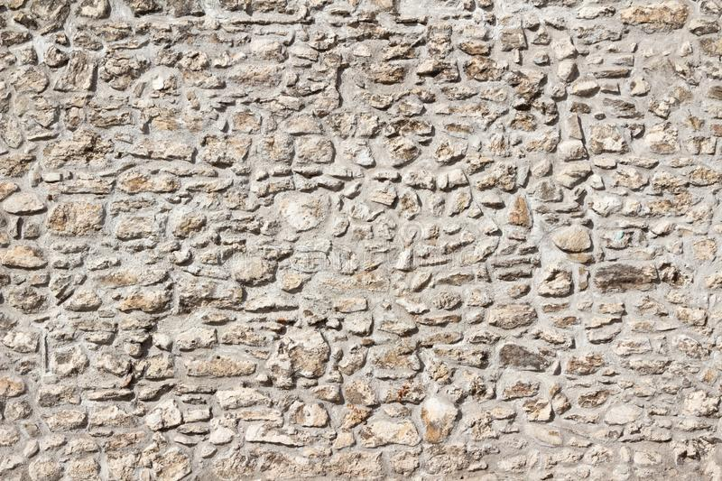 Renovated Medieval stone city wall texture. Renovated Medieval stone city wall of Sopron, Hungary stock image