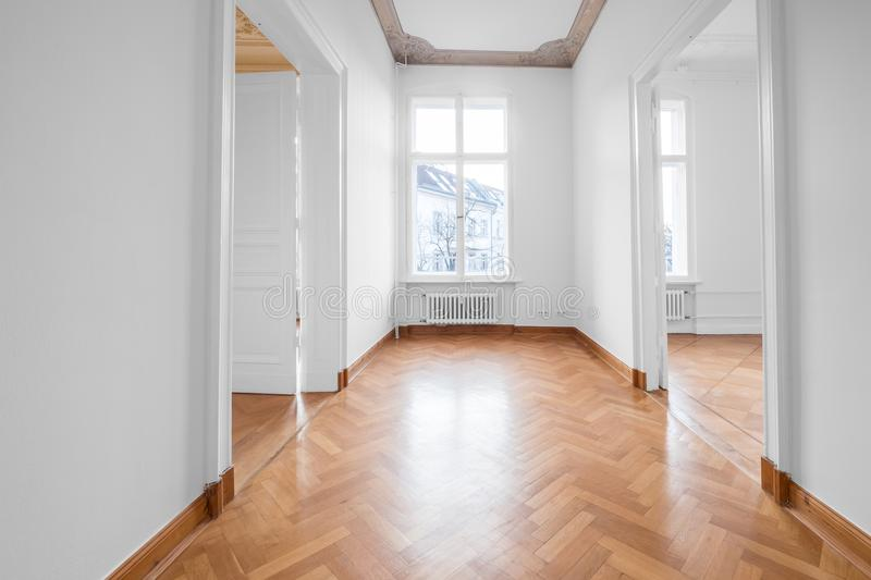 renovated old building room, flat with stucco ceiling and parquet floor royalty free stock photography