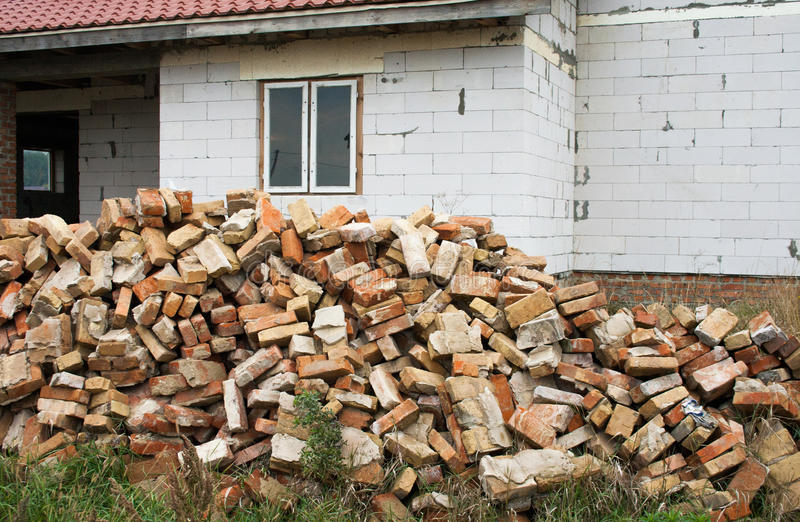 Renovated old house. Dismantling of old brick. A pile of red bricks royalty free stock photography