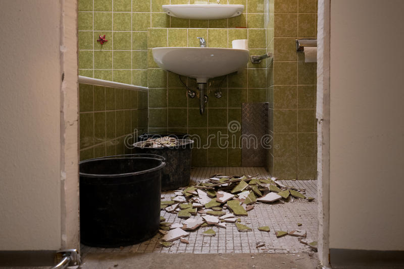 Renovation of a Bathroom. With old green tiles royalty free stock images