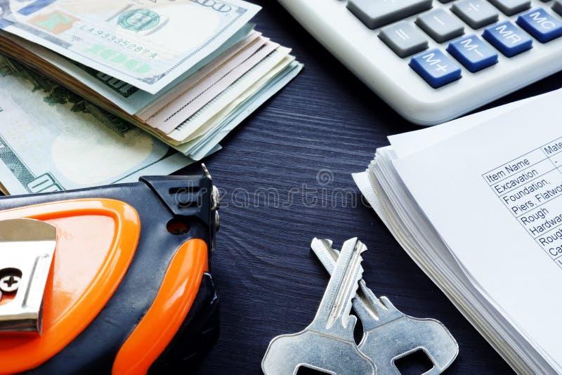 Renovation cost. Money, keys and budget estimate list. Renovation cost concept. Money, keys and budget estimate list royalty free stock photo