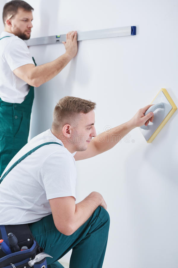 Renovation crew being at work. Picture of a renovation crew being at work stock photos