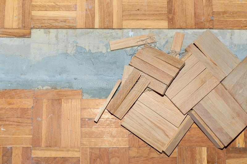Fixing damaged parquet stock images