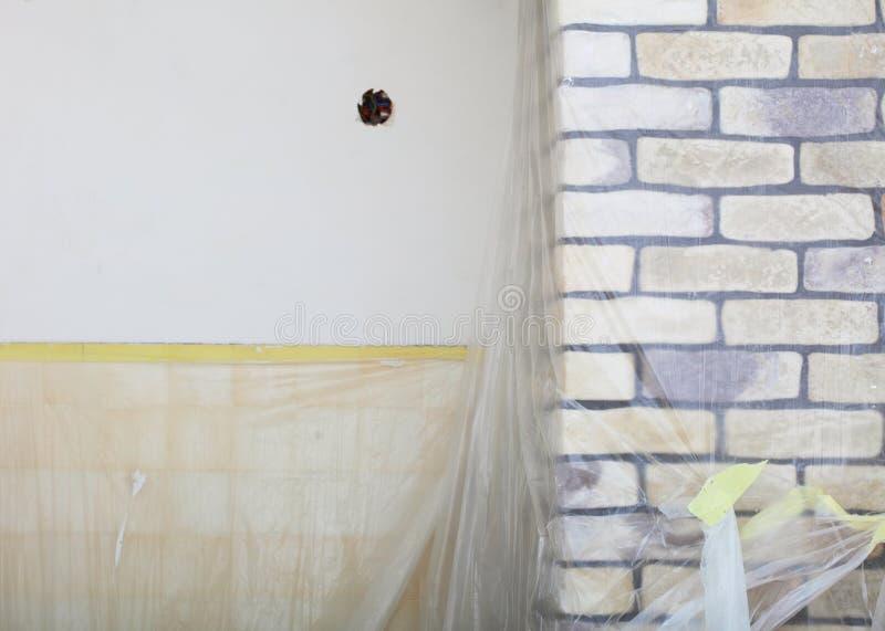 Renovation at home decorate wall clinker brick tile glue. Improvement renovation at home decorate wall clinker brick tile glue finishing royalty free stock photos