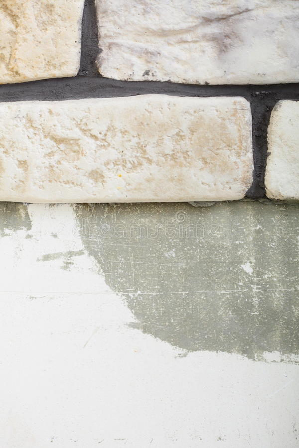 Renovation at home wall clinker tile glue. Base and finish for laying tiles royalty free stock photo