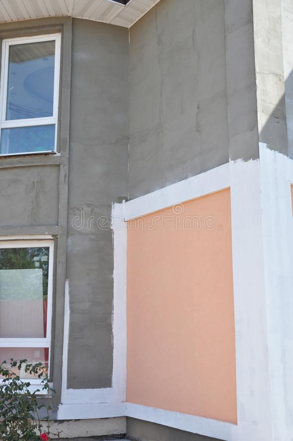 Renovation house paint walls outdoors. Painting house wall exterior. Unfinished house plastering and painting walls outdoor. Photo stock photo