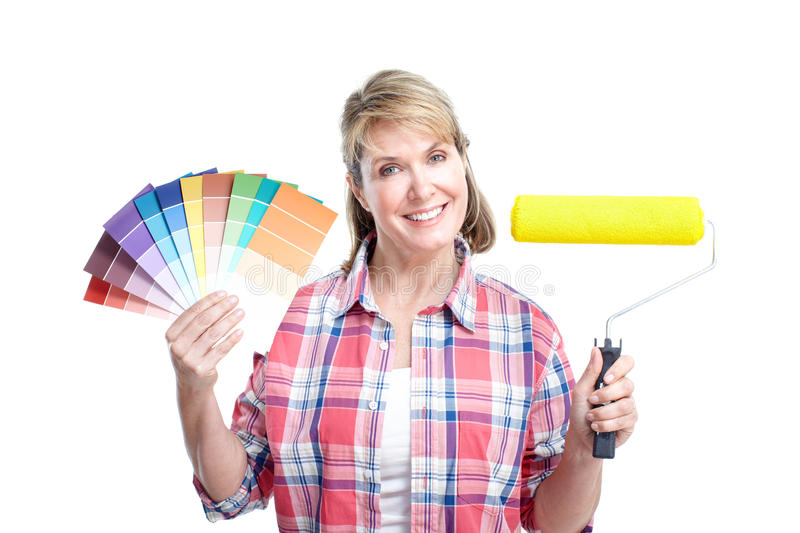 Renovation. Senior lady with painting tools. Over white background stock images