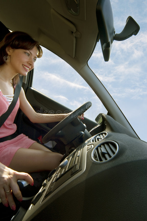 Rent a car!. Young happy woman driving a car