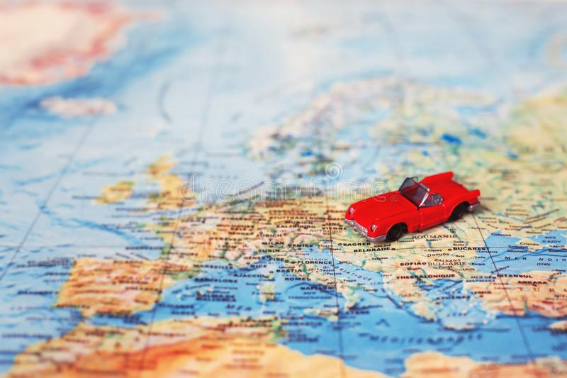 Rent car concept, rental vehicle. Toy on the map stock photography