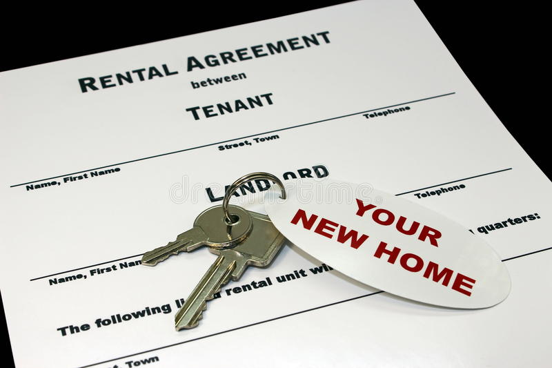 Rental agreement. A rental agreement and the keys of your new home royalty free stock photography
