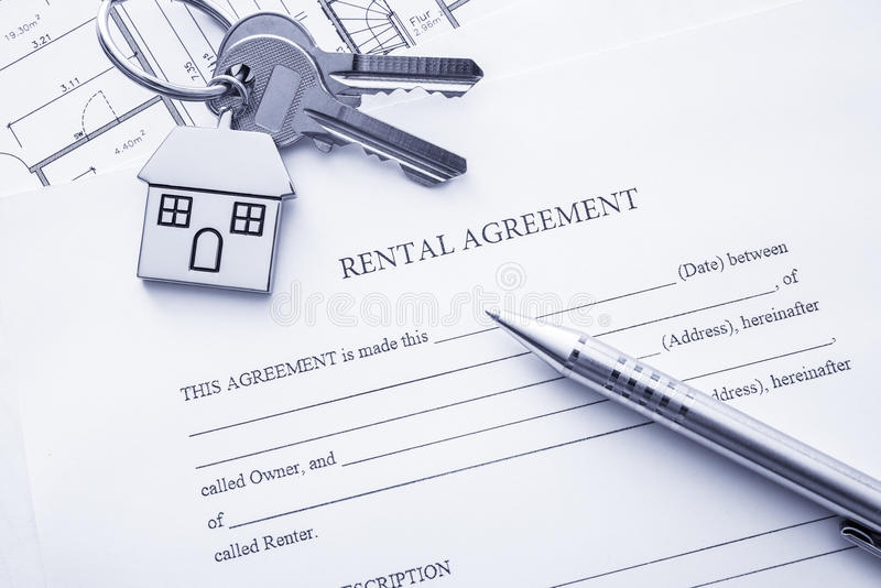 Rental agreement. Document with keys and pencil stock image
