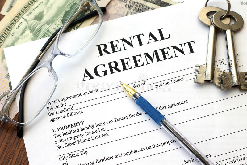 Rental agreement with dollars and keys. Close-up stock images