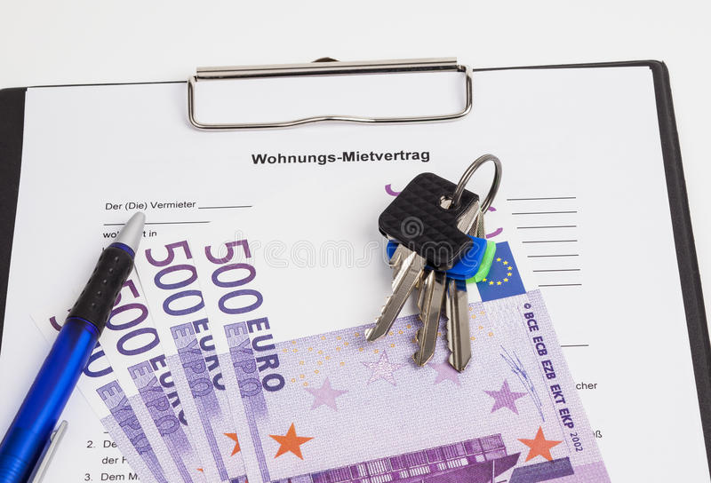 Rental agreement. The image shows a rental agreement,door keys and some Euro banknotes royalty free stock image