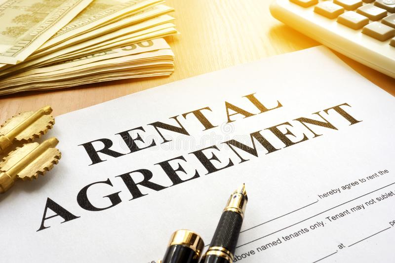 Rental agreement on an office table. A Rental agreement, keys and money on an office table royalty free stock image