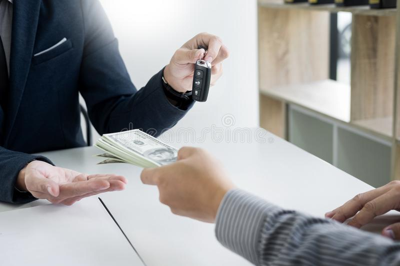 Rental agreement for signing a car insurance policy Document and. Form of a Vehicle Sales Agreement, the agent is holding the document and car key stock photos