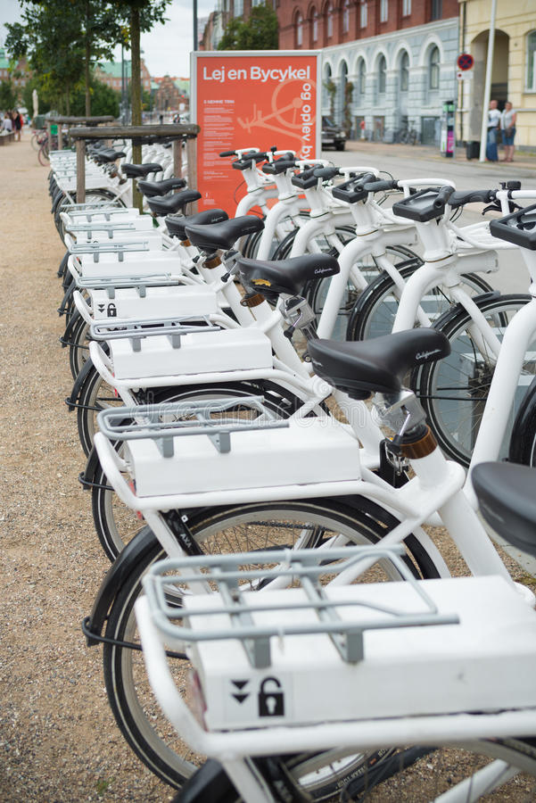 Rental bicycles in copenhagen. COPENHAGEN, DENMARK - JULY 31, 2016: Row of white rental Go-bikes, which can be hired per hour royalty free stock images