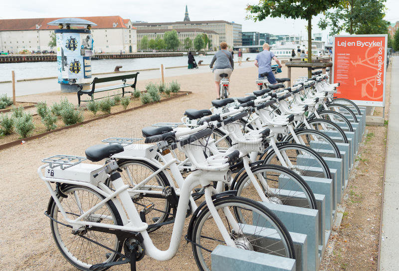 Rental bicycles in copenhagen. COPENHAGEN, DENMARK - JULY 31, 2016: Row of white rental Go-bikes, which can be hired per hour royalty free stock photos
