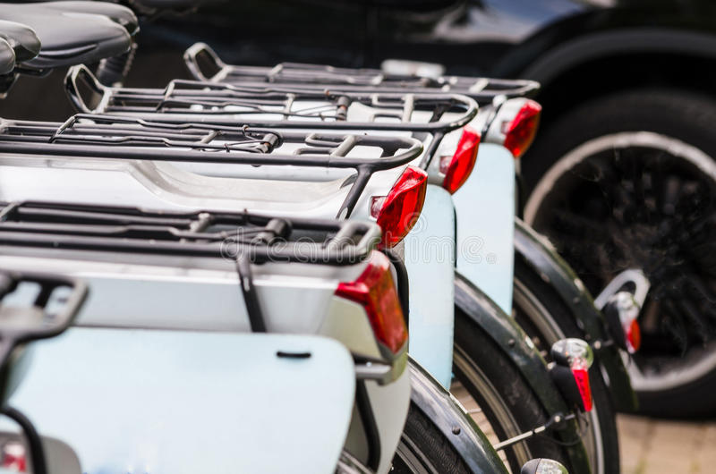 Rental bikes. At a bike rental. View bicycles from behind stock image