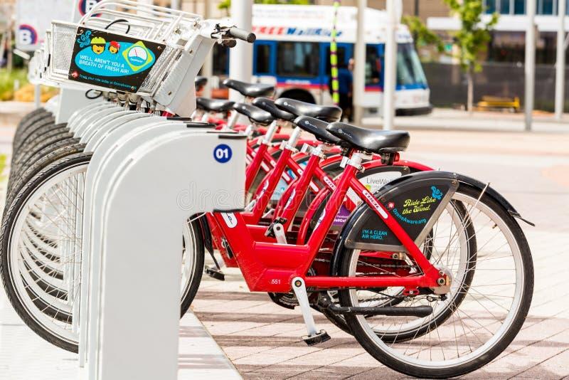 Rental bikes. Denver, Colorado, USA-May 17, 2015. Row of red rental bikes at the Union Station in Denver, Colorado stock photos