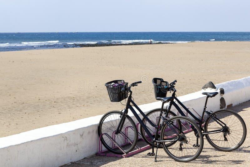 Rental bikes on Lanzarote. Rental bikes near the beach at Playa Honda on Lanzarote stock photo
