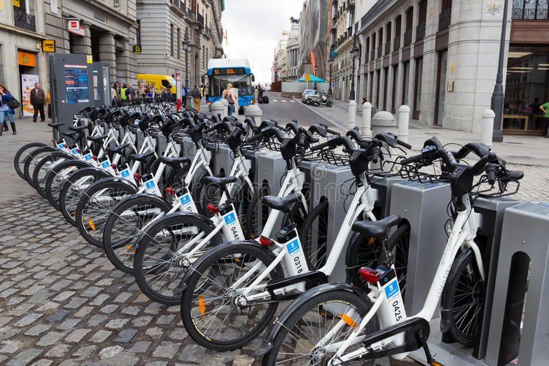 Rental bikes. MADRID - OCTOBER 10: Bikes parked on the sidewalk, belonging to Madrid public system (BiciMad) on October 10, 2014 in Madrid Spain stock images