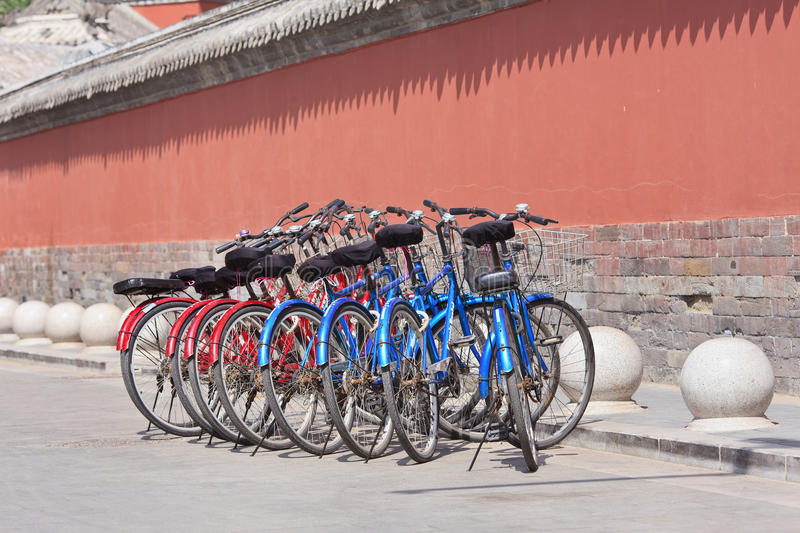 Rental bikes parked near a historical building, Beijing, China stock photo