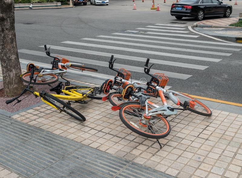Rental bikes on street in Xiamen China stock photos