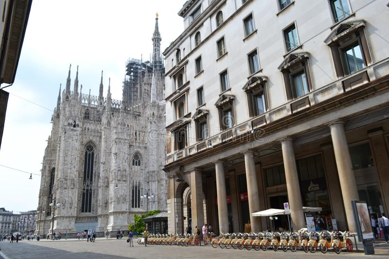 Rental citybikes branded EXPO Milano 2015 are parked at the station near Duomo of Milan. stock photography