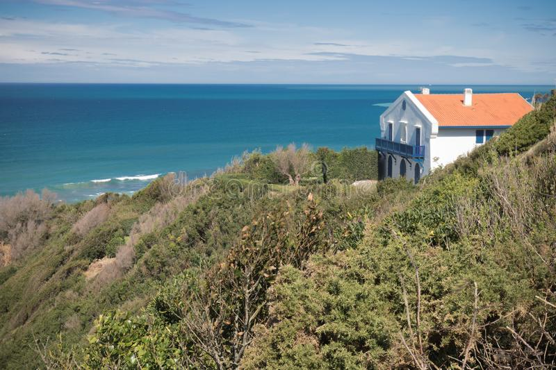 Rental house on a cliff by atlantic ocean coastal footpath with scenic panoramic view stock image