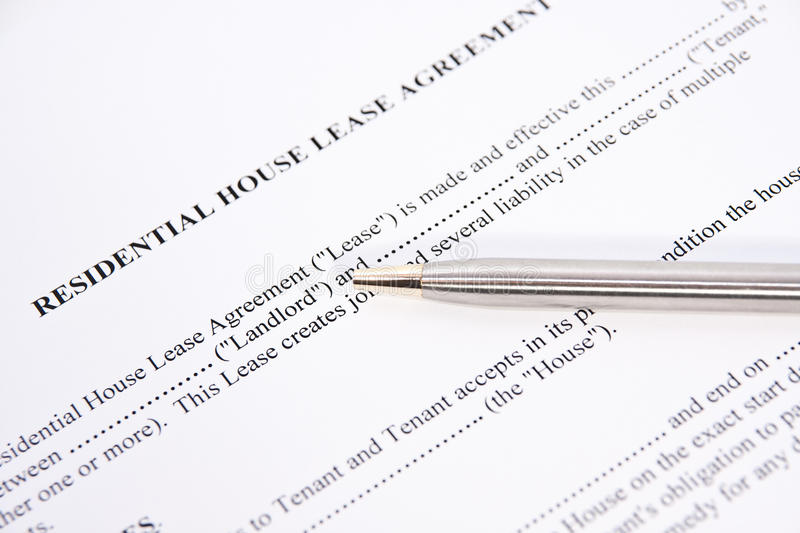 Rental lease agreement. Residential house rental lease agreement and gold pen royalty free stock photo