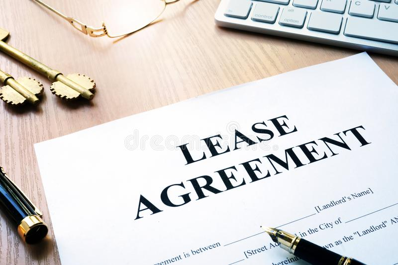 Rental lease agreement form. Rental lease agreement form on an office desk royalty free stock photos