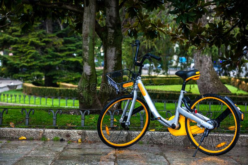 Rental public bike parked on a rainy day. Madrid royalty free stock photos