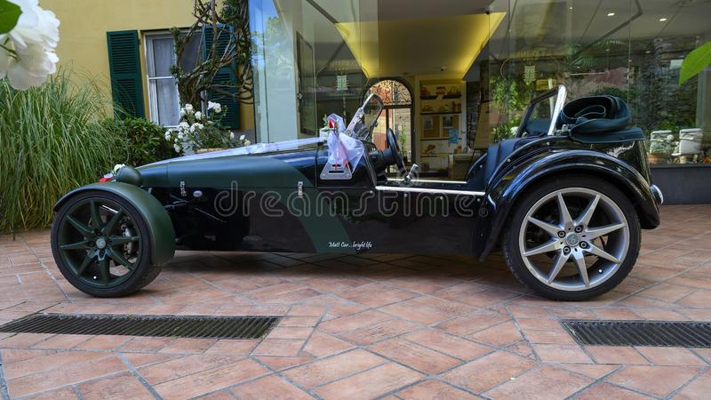 Rental roadster convertible with bows for wedding, Camogli, Italy. Pictured is a rental roadster convertible decorated with bows for a wedding in Camogli, Italy royalty free stock image