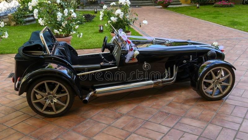 Rental roadster convertible with bows for a wedding, Camogli, Italy stock photography