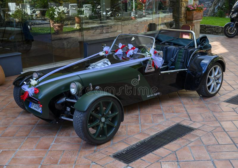 Rental roadster for wedding, Camogli, Italy. Pictured is a rental roadster decorated with bows for a wedding in Camogli, Italy.  The roadster has the name of the royalty free stock photography