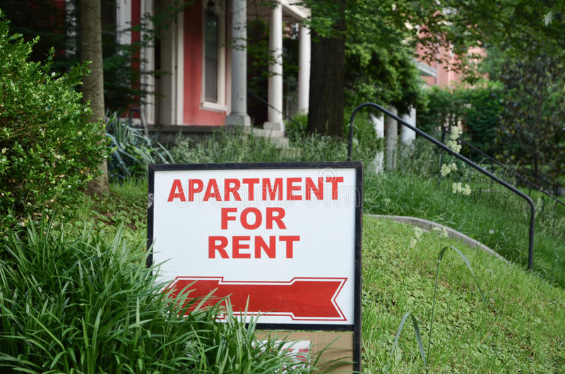 Rental Sign. Apartment for rent sign displayed on residental street. Shows demand for housing, rental market, landlord-tenant relations stock photography