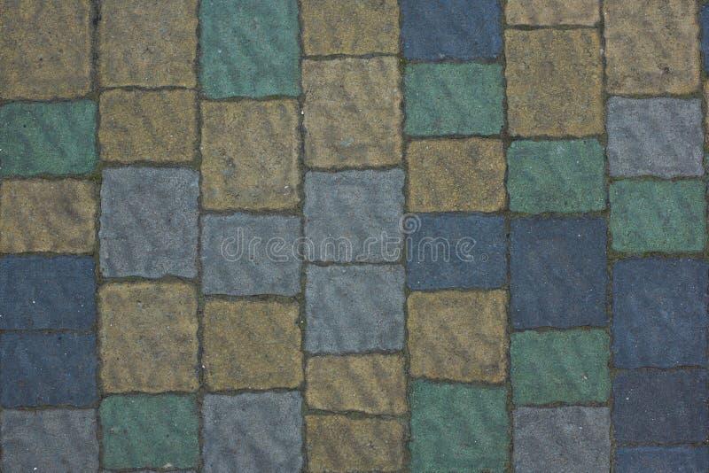 Renueve la textura de pavimentación de piedra multicolora Resuma el fondo estructurado del modelo moderno de las losas del pavime foto de archivo libre de regalías