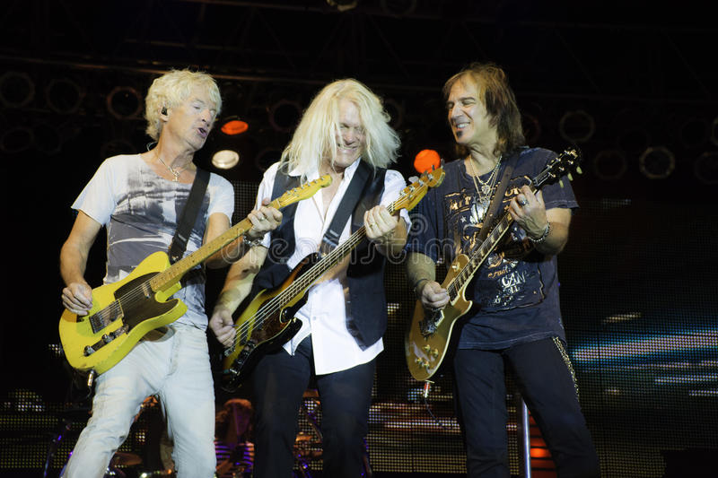 REO Speedwagon Dave Amato. REO Speedwagon performs onstage 2014. Dave Amato,Kevin Cronin and Bruce Hall royalty free stock images