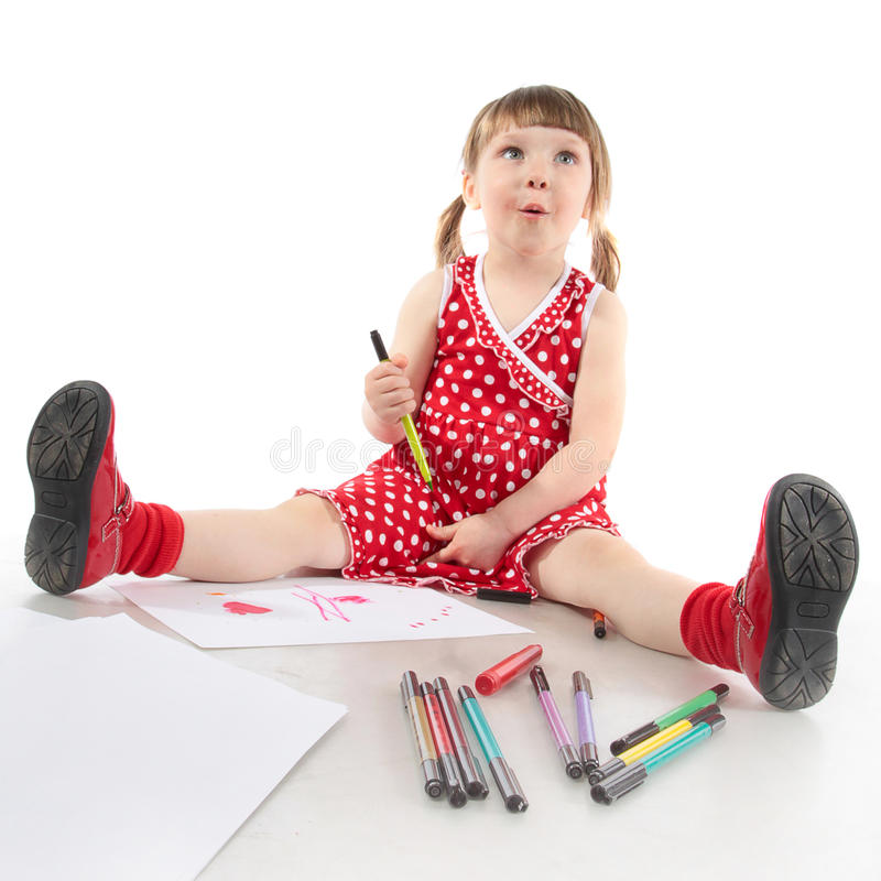 Repères dans les mains de l'enfant heureux enthousiaste photographie stock
