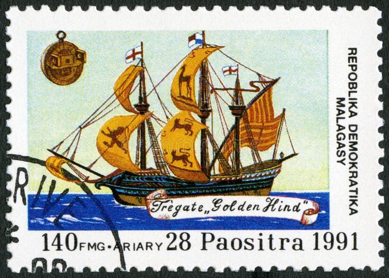 REPÚBLICA MALGAXE - 1991: devotado ao 500th aniversário da descoberta de América, traseiro dourado das mostras imagem de stock royalty free