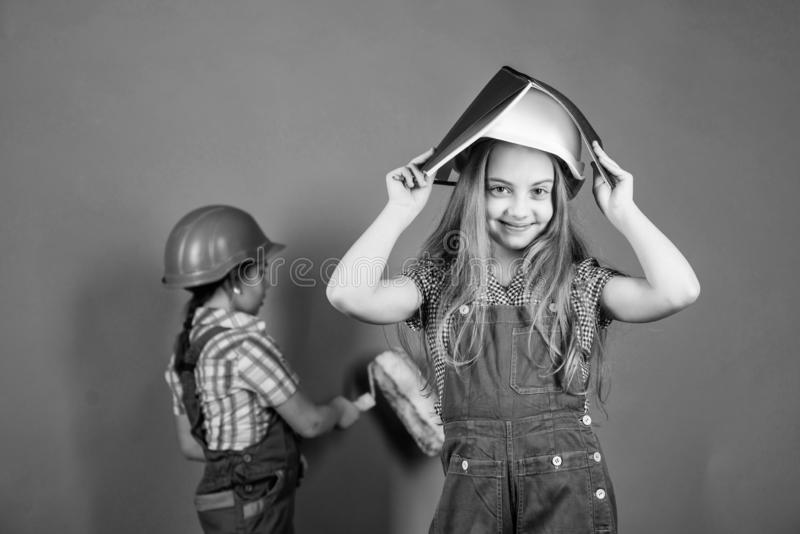 Repaint walls. Move in new apartment. Children sisters run renovation their room. Sisters happy renovating home. Home. Improvement activities. Renovation team stock image