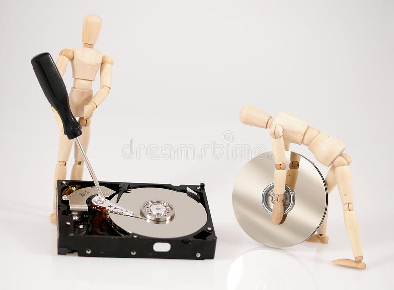 Repair. Wooden puppets with hardware on white background royalty free stock image