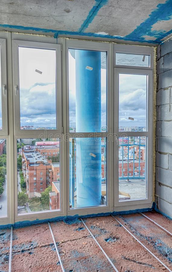 Repair of the balcony in the apartment. Preparing to fill the floor. Home renovation stock image