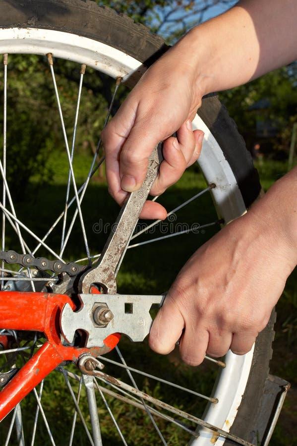 Repair of bicycle stock photo