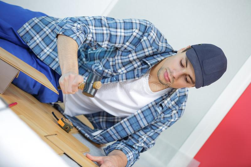 Repair building and home concept - male measuring wood flooring stock images