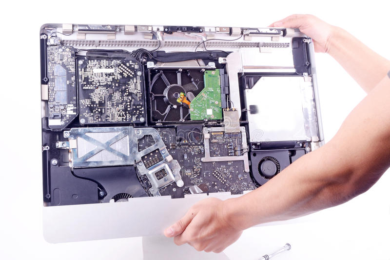 Repair computer. A man repair imac computer change harddisk royalty free stock photo