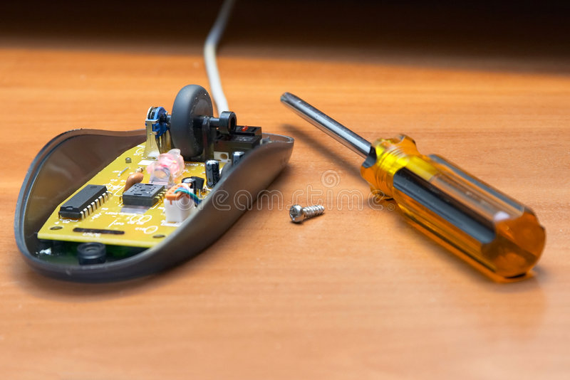 Repair of the computer mouse. royalty free stock photos